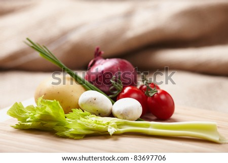raw vegetables on a chopping board