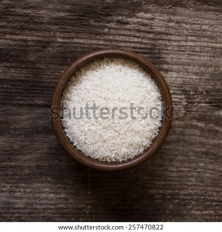raw white rice in a bowl - top view - stock photo