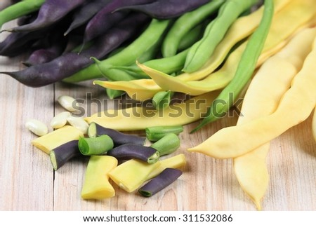Raw yellow, green and violet beans - stock photo