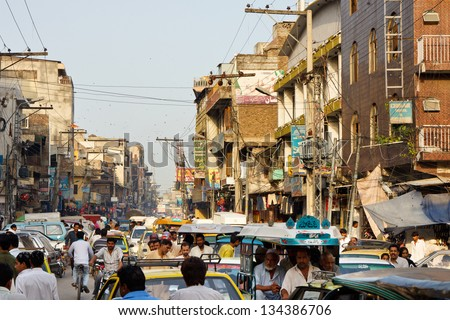 RAWALPINDI, PAKISTAN - JULY 16: Heavy traffic at Raja Bazaar on July 16, 2011 in Rawalpindi, Pakistan. Raja Bazaar is the main shopping area and tourist attraction in Rawalpindi. - stock photo