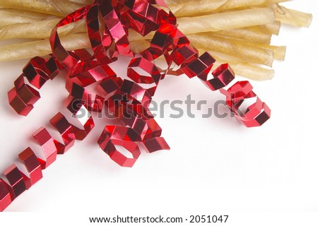 Rawhide dog treats are bundled into a Holiday package.