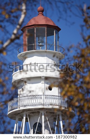Rawley Point Lighthouse by Lake Michigan in Wisconsin. Seen from the forest. - stock photo