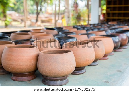 Raws of clay pots for sell standing outside - stock photo