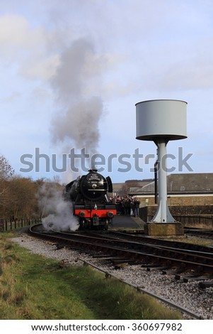 Rawtenstall, Lancashire, U.K. - January 10, 2016: Refurbished locomotive, The Flying Scotsman, on it inaugural weekend in service on the East Lancashire Railway on January 10, 2016. - stock photo