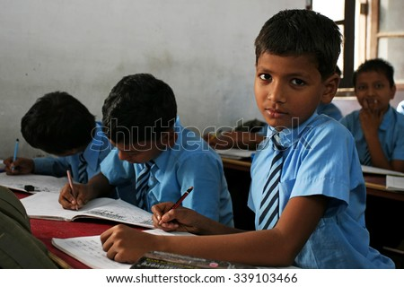 RAXAUL, INDIA - NOV 5: Unidentified Indian boys in a local school on Nov 5, 2011 in Raxaul, Bihar state, India. Bihar is one of the poorest states in India. The per capita income is 300 dollars. - stock photo