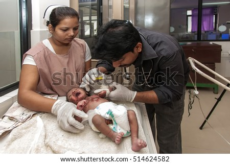 RAXAUL, INDIA - NOV 13: Unidentified Indian doctor and nurse working at a neonatal intensive care unit of a hospital on November 13, 2013 in Raxaul, Bihar, India.