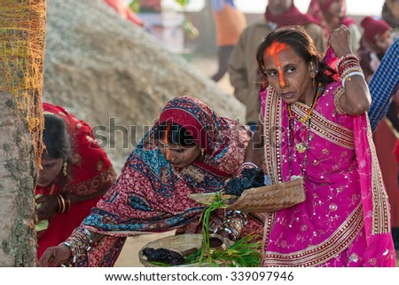 RAXAUL, INDIA - NOV 9: Unidentified Indian women at the religious Chhath festival on Nov 9, 2013 in Raxaul, Bihar state, India. Bihar is one of the poorest states in India.