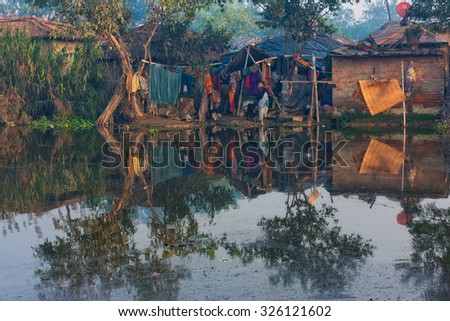 RAXAUL - NOV 7: Houses of a poor Indian town on Nov 7, 2013 in Raxaul, Bihar state, India. Bihar is one of the poorest states in India. The per capita income is about 300 dollars.