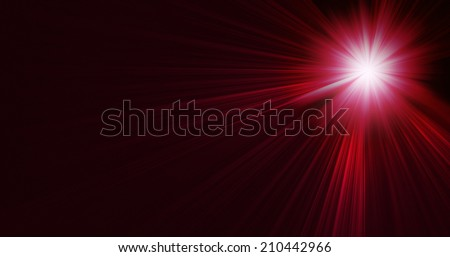 Ray of stage lighting on red background - stock photo