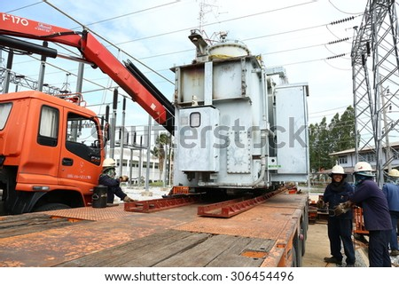 RAYONG -THAILAND - AUGUST 5 :Workers are preparing the process of moving the old transformers large, up trailer. August 5, 2015 in Rayong province, Thailand