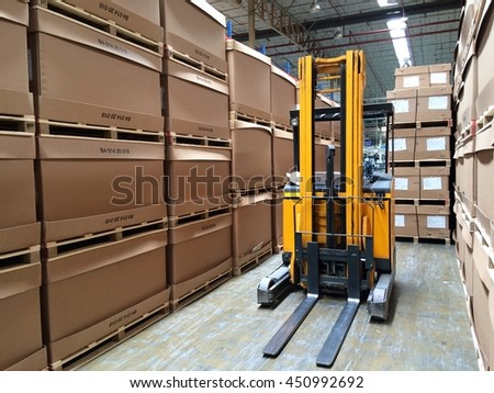 Rayong Thailand , July 12 - 2016 ; Lift truck in factory warehouse use for move material supply production process line.