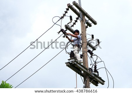 Rayong - Thailand , June 16 - 2016 : Electrician maintenance electrical high voltage systen in Thailand Rayong plant.