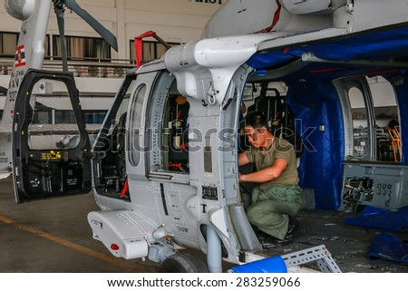 RAYONG , THAILAND- MAR 26, 2015: Sikorsky UH-60 Black Hawk helicopter of royal thai navy standby in the hangar for maintenance. U-TAPAO Airport, Rayong - stock photo