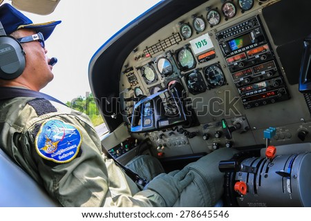 RAYONG , THAILAND- MAY 16 2015: Aviator of Cessna 208 Caravan no.1918 of KASET, Bureau of Royal Rainmaking and Agricultural Aviation. U-TAPAO Airport, Rayong - stock photo