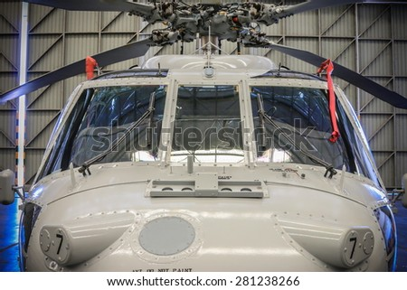 RAYONG , THAILAND- MAY 16, 2015: Front of Sikorsky UH-60 Black Hawk helicopter of royal thai navy standby in the hangar for maintenance. U-TAPAO Airport, Rayong - stock photo