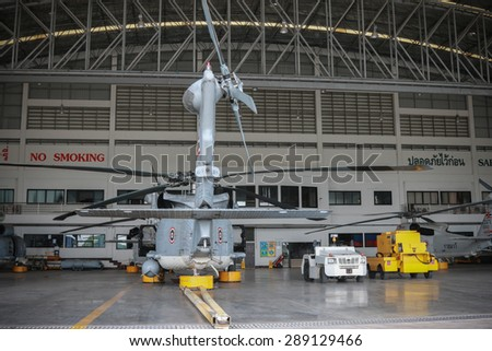 RAYONG , THAILAND- MAY 26, 2015: Sikorsky UH-60 Black Hawk helicopter No.3208 of royal thai navy standby in the hangar for maintenance. U-TAPAO Airport, Rayong - stock photo