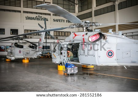RAYONG , THAILAND- MAY 16 2015: Sikorsky UH-60 Black Hawk helicopter of royal thai navy standby in the hangar for maintenance. U-TAPAO Airport, Rayong - stock photo
