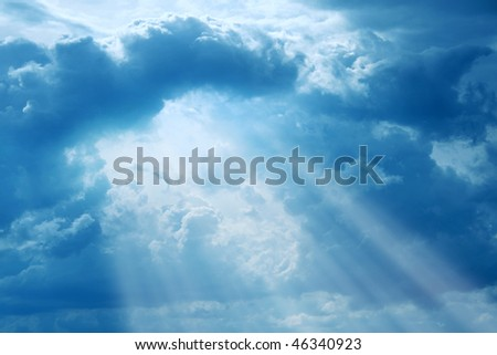 Rays of light and dramatic sky. - stock photo
