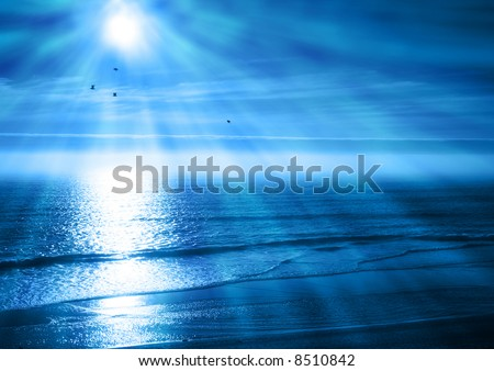 Rays of Light Beam Down on a Blue Ocean Sunset - stock photo
