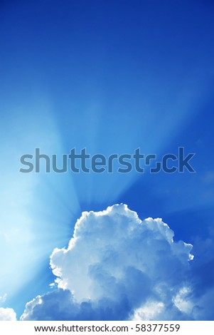Rays of light in blue sky. - stock photo