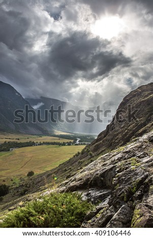 Rays of light. Low clouds on the way to Mushroom rocks, Altai.
