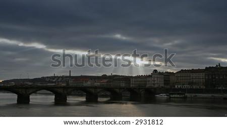 Rays of light over old European city - stock photo