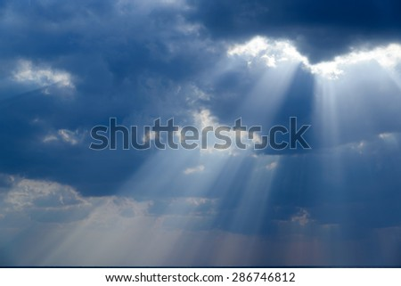 Rays of light shining down - stock photo