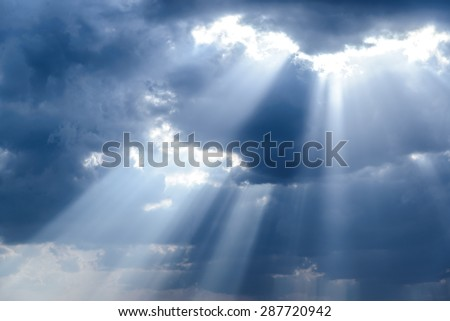 Rays of light shining down in the morning - stock photo