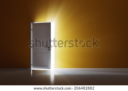 Rays of light through the open white door on orange wall - stock photo