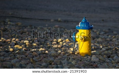 Rays of sunlight shine on a fire hydrant. - stock photo
