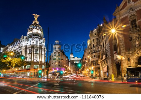 Rays of traffic lights on Gran via street, main shopping street in Madrid at night. Spain, Europe. - stock photo