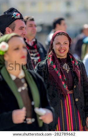 "RAZLOG, BULGARIA - APRIL 13, 2015: Smiling female Bulgarian folklore dancer during the traditional folklore festival ""1000 national costumes"" - stock photo"