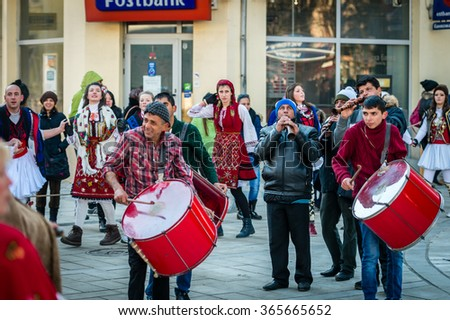 Razlog, Bulgaria - January 01, 2016: People in costumes are taking part in the festival of Mummers in Razlog, Bulgaria. Games, dances and activities are organized for viewers.
