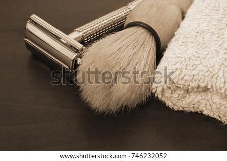 stock-photo-razor-brush-and-towel-close-
