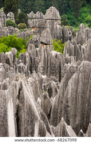 Razor rock mountains at Stone forest national park in Yunnan province, China - stock photo