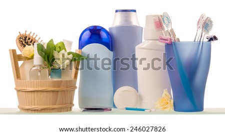 Razors and lotion with deodorant over white background - stock photo
