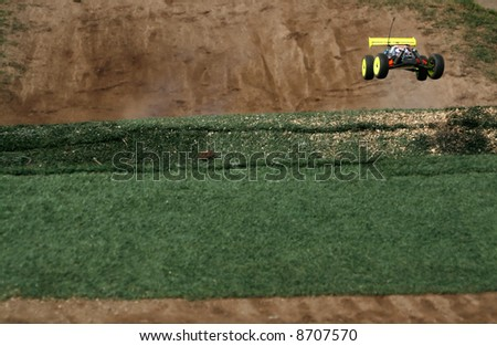rc toy car rally on dirt track - stock photo