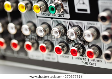 RCA sockets of audio surround receiver amplifier - stock photo
