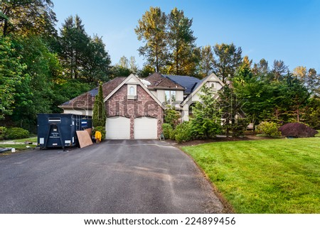 Re-roofing suburban house: old cedar shakes partially removed - stock photo