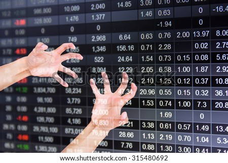 Reaching a hand.on stock market chart background,Hand feel Concept