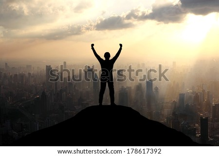 Reaching the summit of a mountain - stock photo