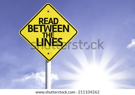 Read Between the Lines road sign with sun background  - stock photo