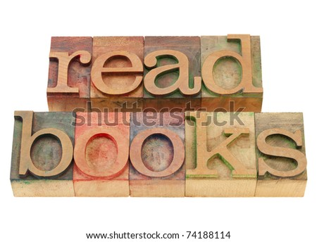 read books  suggestion in vintage wood letterpress printing blocks, isolated on white
