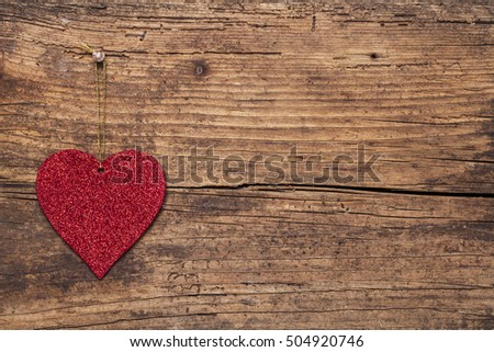 Read heart  on  wooden background.Valentines Day background with hearts.