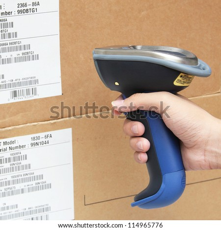 Reading and Scanning label on the boxes with bluetooth barcode scanner - stock photo