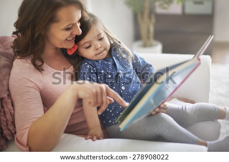 Reading books with mommy make me happier - stock photo