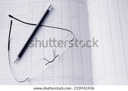 Reading eyeglasses and a pencil on annual Income tax report bookkeeping. Concept photo of tax, taxation, income, freelancer, self employed, tax returns, money, finance, economy, small business. (BW) - stock photo