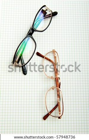 Reading glasses on the black page - stock photo