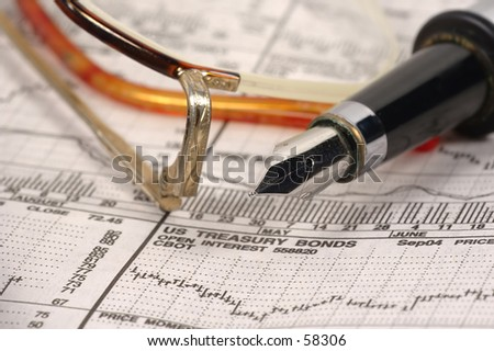 Reading Glasses,Pen and Stock Quotes