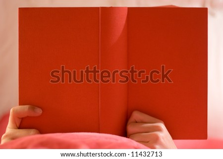 Reading in Bed - stock photo